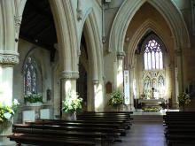 St Michael and All Angels Roman Catholic church, Belmont Abbey, Herefordshire: view from the nave toward the chancel and north aisle.  Photo Credit: Poemen